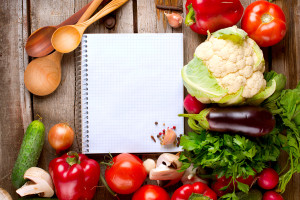 Vegetables and Spices on a Wooden Background and Paper for Notes