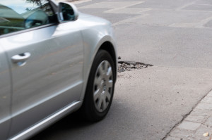 Asphalt`s Holes On Roadbed. Car In A Motion.